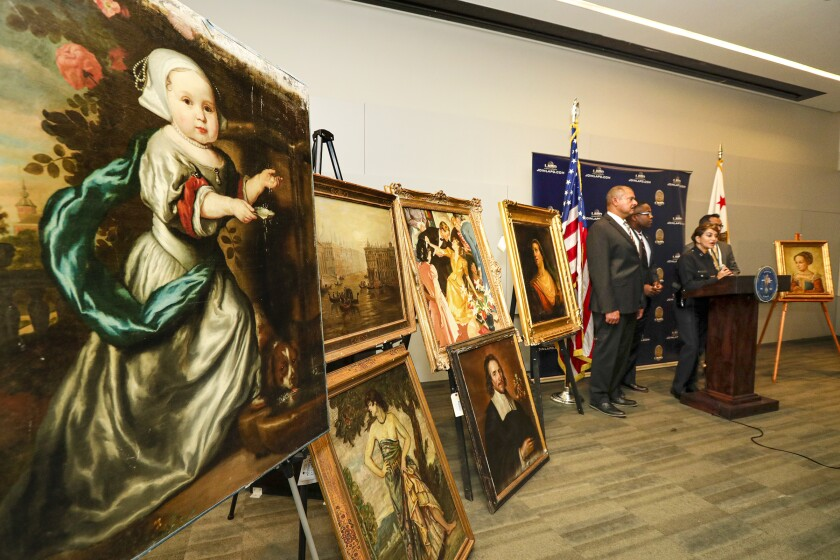 Paintings on easels at a police news conference