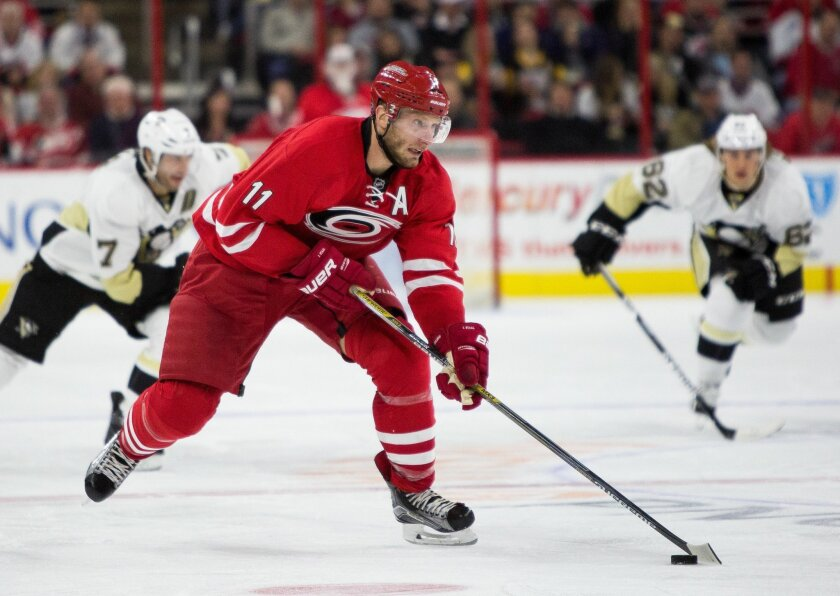Carolina Hurricanes' Jordan Staal (11) handles the puck as Pittsburgh Penguins' Matt Cullen (7) and Carl Hagelin (62), of Sweden, follow during the second period of an NHL hockey game in Raleigh, N.C., Friday, Feb. 12, 2016. (AP Photo/Ben McKeown)