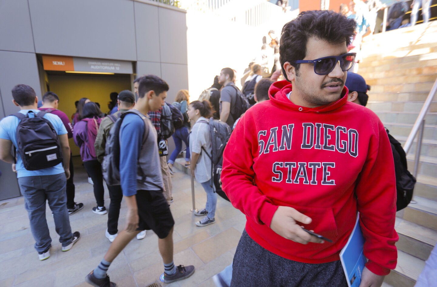 Sal Almul, a computer engineering student at San Diego State University waits for his next class to begin.