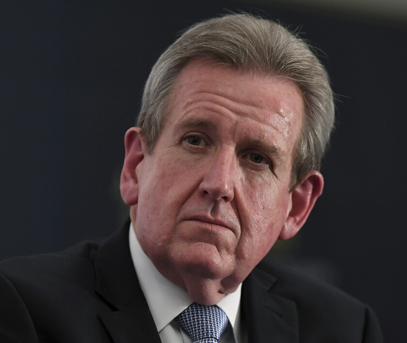 """Former NSW Premier Barry O'Farrell joins a CEDA panel discussing Australia's economic strategy in India in Sydney on Aug. 2, 2018. Around half the passengers due to fly from India to Australia on Saturday after a two-week travel ban have been grounded because they either have COVID-19 or are considered a close contact of someone who does. Now Australian High Commissioner to India O'Farrell said """"a number"""" of passengers booked to fly would not board the flight at New Delhi on Friday, May 14, 2021 because they had tested positive to COVID-19. (Joel Carrett/AAP Image)"""