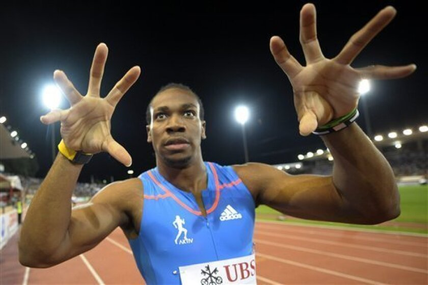 Yohan Blake from Jamaica celebrates after winning the men's 100-meter race, at the Athletissima IAAF Diamond League athletics meeting in the Stade Olympique de la Pontaise in Lausanne, Switzerland, Thursday, Aug. 23, 2012. (AP Photo/Keystone, Jean-Christophe Bott)