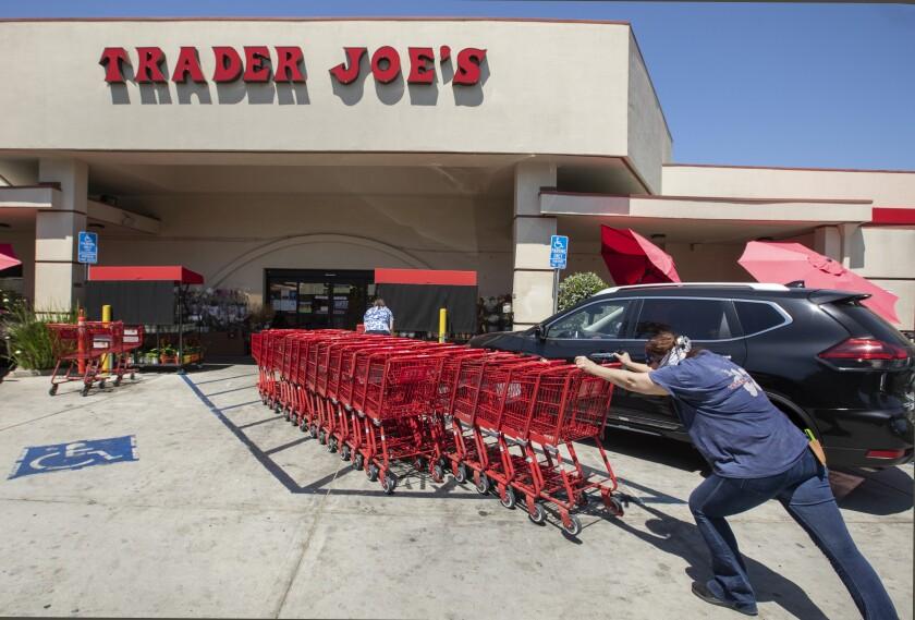 Shopping carts are returned outside Trader Joe's.