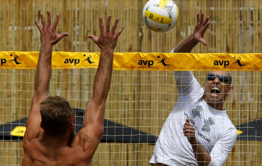Nick Lucena tries to power the ball past Madison McKibbin during a match at the AVP Huntington Beach Open on Friday.