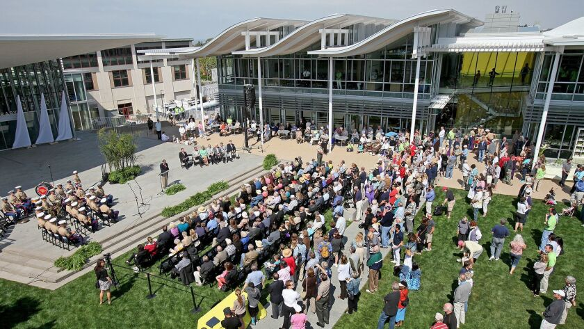 Visitors gather in the Civic Green during an opening ceremony for the City of Newport Beach's new Ci