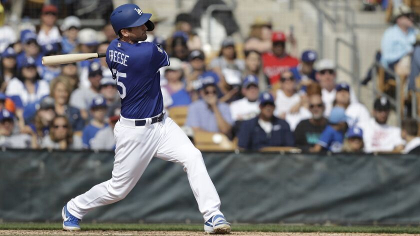 Dodgers' David Freese hits during a spring training game in Glendale, Ariz.