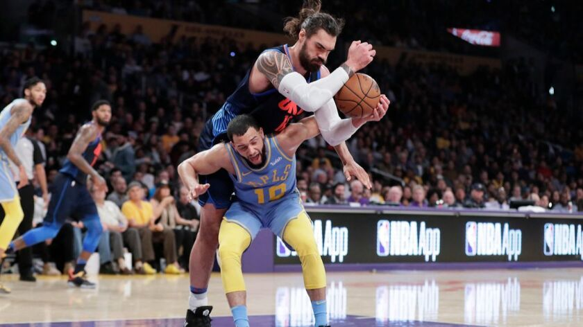 Oklahoma City Thunder center Steven Adams climbs over the back of Lakers forward Larry Nance Jr. for a second-half rebound at Staples Center on Wednesday.