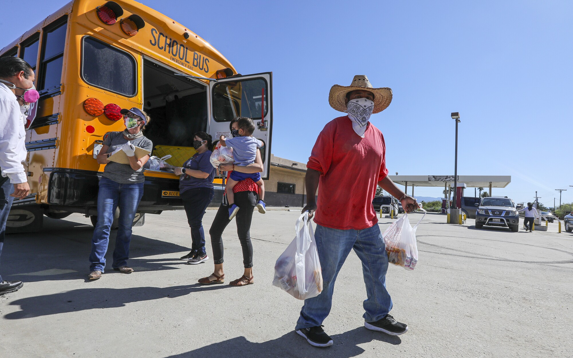 Coachella Valley Unified School District delivers meals in front of Oasis Mobile Home Park in Thermal