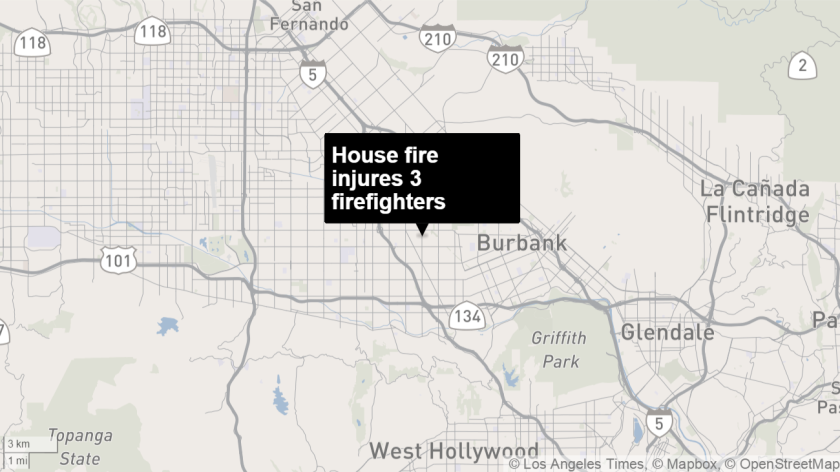 Three firefighters were injured in a fast-growing blaze in North Hollywood Tuesday.