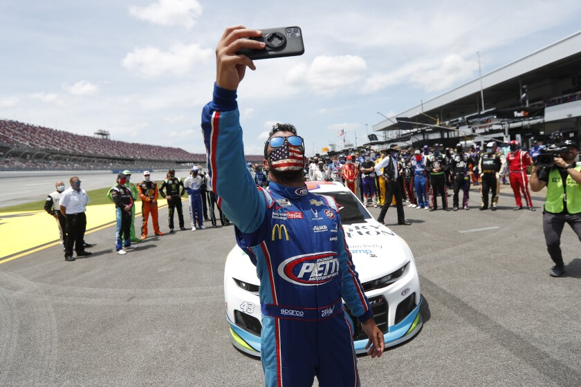 Bubba Wallace takes a photo of himself and other drivers at Talladega Superspeedway.