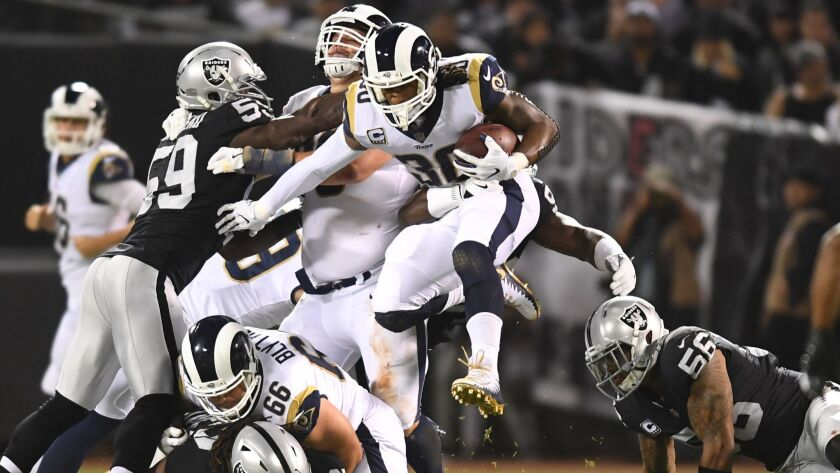 OAKLAND, CALIFORNIA SEPTEMBER 10, 2018-Rams running back Todd Gurley leaps over the defense to pick