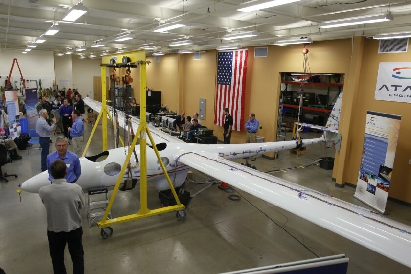 The Perlan II glider -- an experimental plane that pilots will try to fly to an altitude of 19 miles -- is undergoing stress testing at ATA Engineering in Sabre Springs.