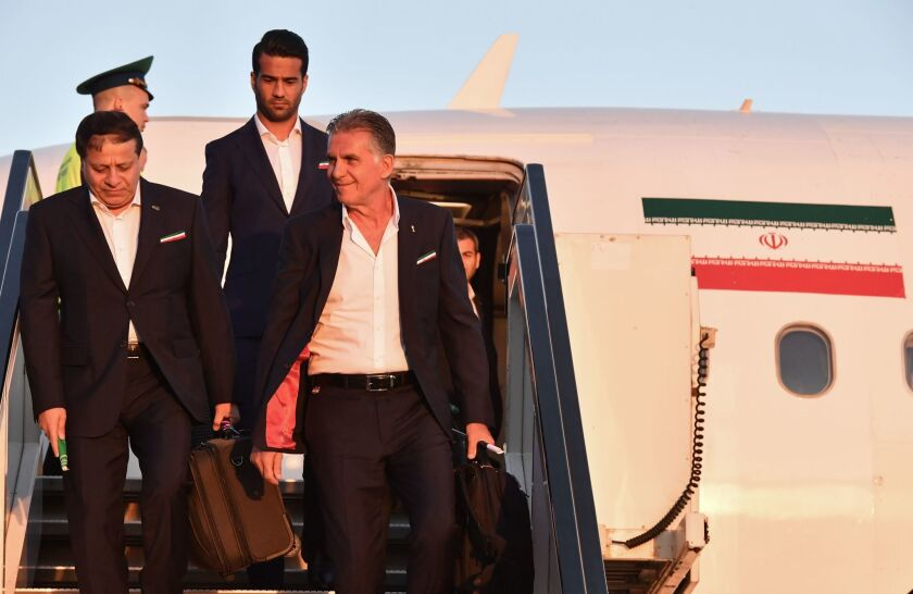 Iran's national football team Portuguese coach Carlos Queiroz and his footballers arrive at Moscow's Vnukovo airport on June 5, 2018, to take part in the 2018 FIFA World Cup football tournament in Russia.