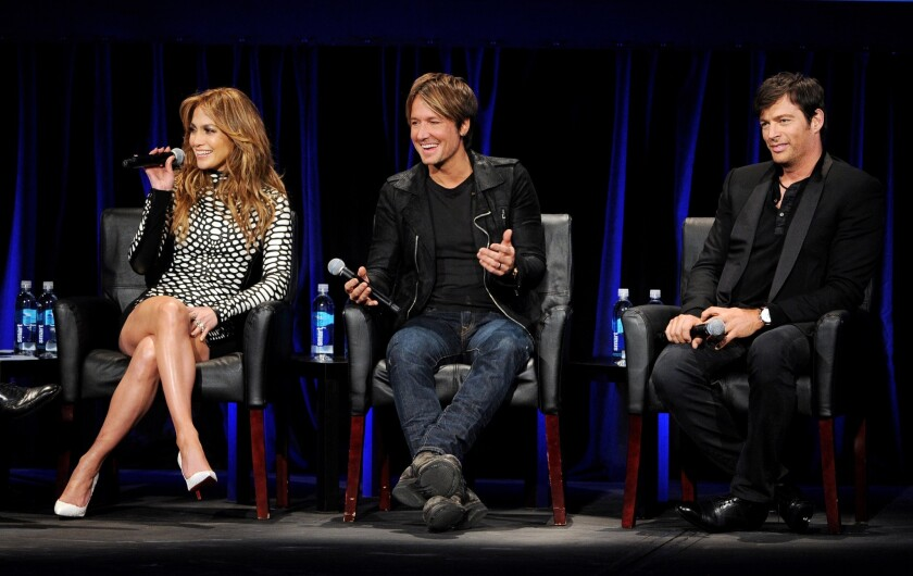 """""""American Idol's"""" current judges are Jennifer Lopez, Keith Urban, center, and Harry Connick Jr."""