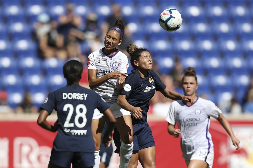 Orlando Pride's Kristen Edmonds (12) and Sky Blue FC's Raquel Rodriguez (11) head the ball during an NWSL match.