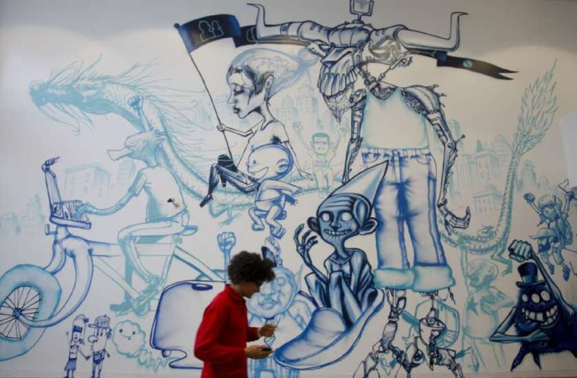 Walls on Facebook's Menlo Park, Calif., campus are decorated by graffiti artist David Choe.
