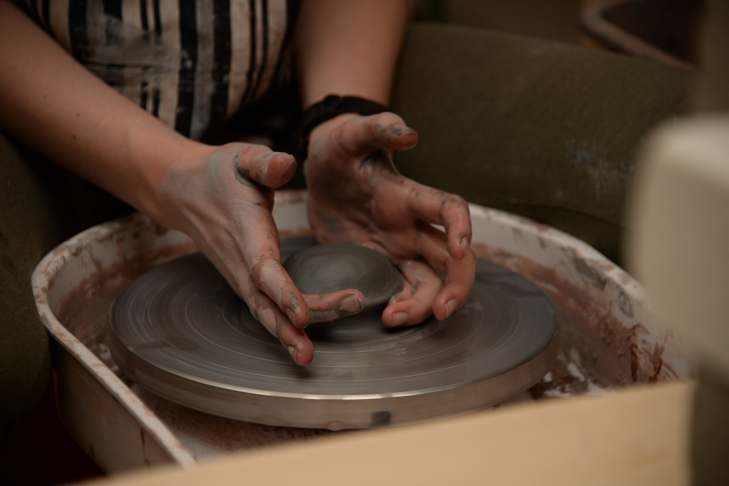 Staff writer Sara Butler attempts making a ceramic on pottery wheel