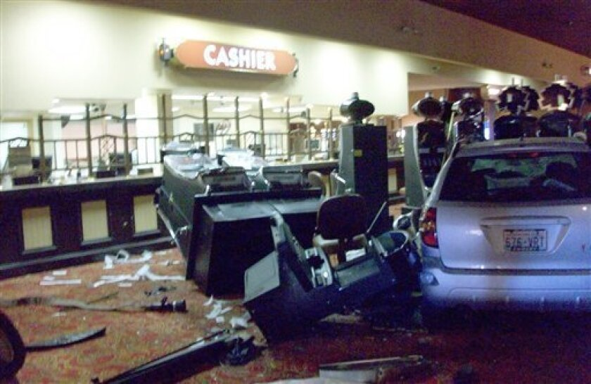 This picture provided by the Bullhead City Fire Department shows damaged slot machines after a speeding car, right, crashed through the entrance of the Edgewater Hotel & Casino Wednesday, Feb. 3, 2010 in the southern Nevada resort town of Laughlin. (AP Photo/Bullhead City Fire Department) NO SALES
