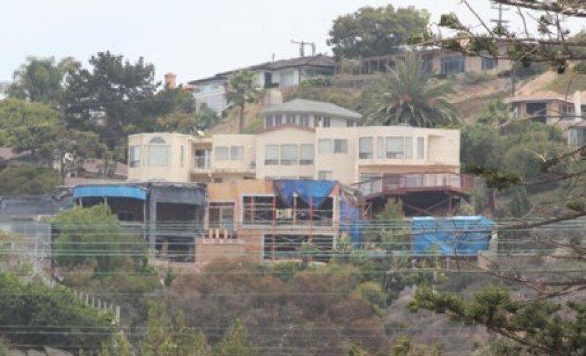 The unfinished home remodel on La Jolla Corona Drive, as seen from La Jolla Boulevard below.