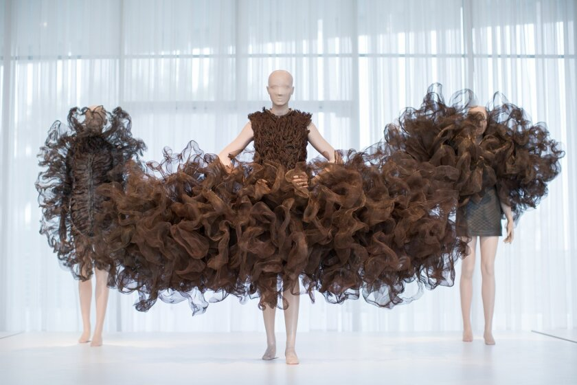 """Dresses from the Refinery Smoke collection by designer Iris van Herpen are displayed at the High Museum's new exhibit, """"Iris van Herpen: Transforming Fashion"""", Thursday, Nov. 5, 2015, in Atlanta. The exhibit, running through May 15, shows the evolution of van Herpen's design from collections create"""