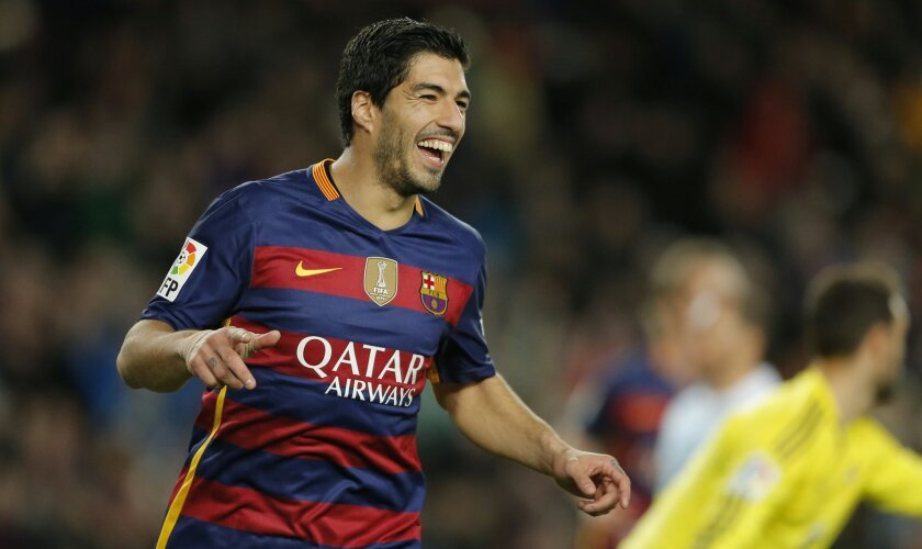 FC Barcelona's Luis Suarez reacts after scoring against Celta Vigo during a Spanish La Liga soccer match at the Camp Nou stadium in Barcelona, Spain, Sunday, Feb. 14, 2016. (AP Photo/Manu Fernandez)