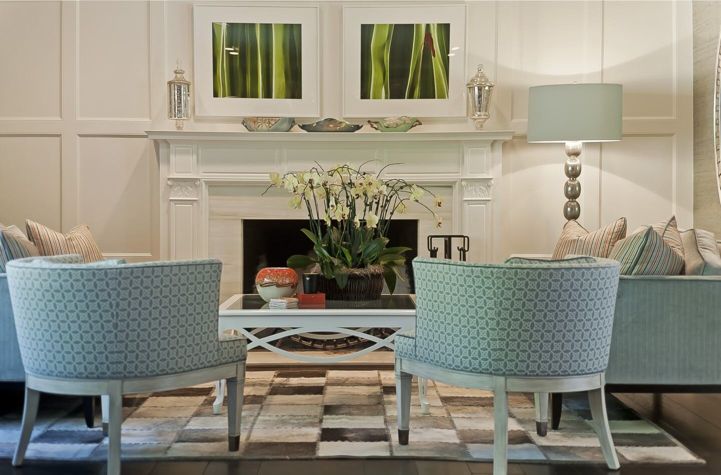 """The living room is less kid-friendly with velvet sofas and a Ralph Lauren cowhide rug. """"We didn't have to be as practical in this room,"""" Michael Ostrow said. All of the room's brown woodwork was painted white, opening up the space and making it less """"muddy."""""""