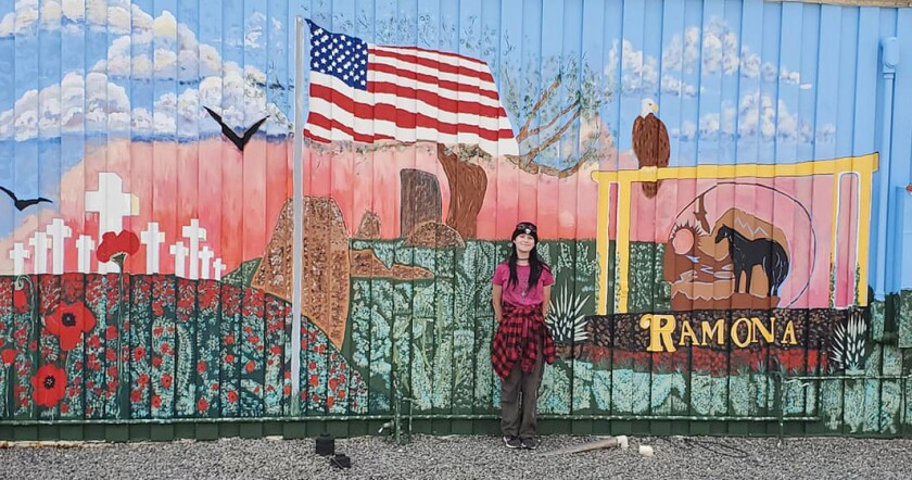 Kimmi Ross, a member of female Scouts BSA Troop 1768, displays the VFW Post mural she completed for her Eagle Scout award.