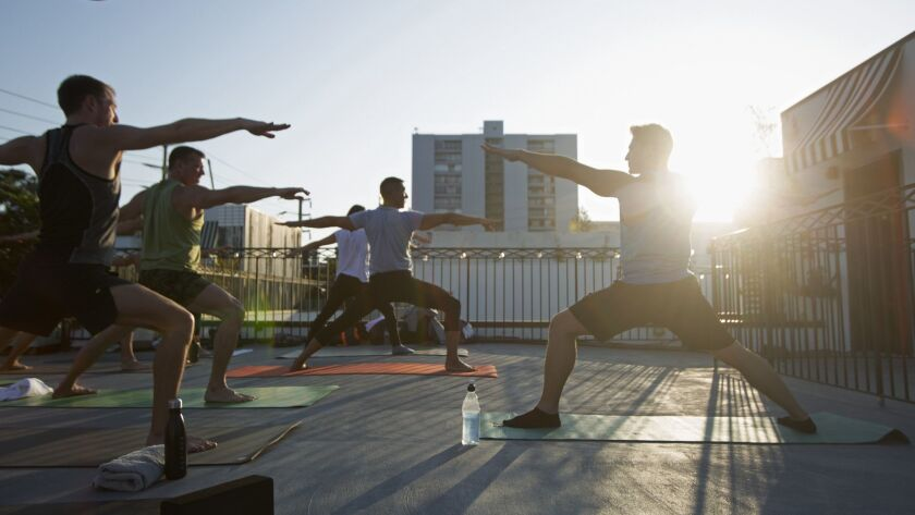 LOS ANGELES, CA-June 6, 2018 Yoga instructor Jake Ferree and violinist Volkan Can Canbolat team up f