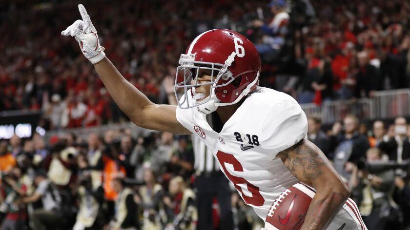 FILE - In this Jan. 8, 2018, file photo, Alabama wide receiver DeVonta Smith (6) celebrates his touc