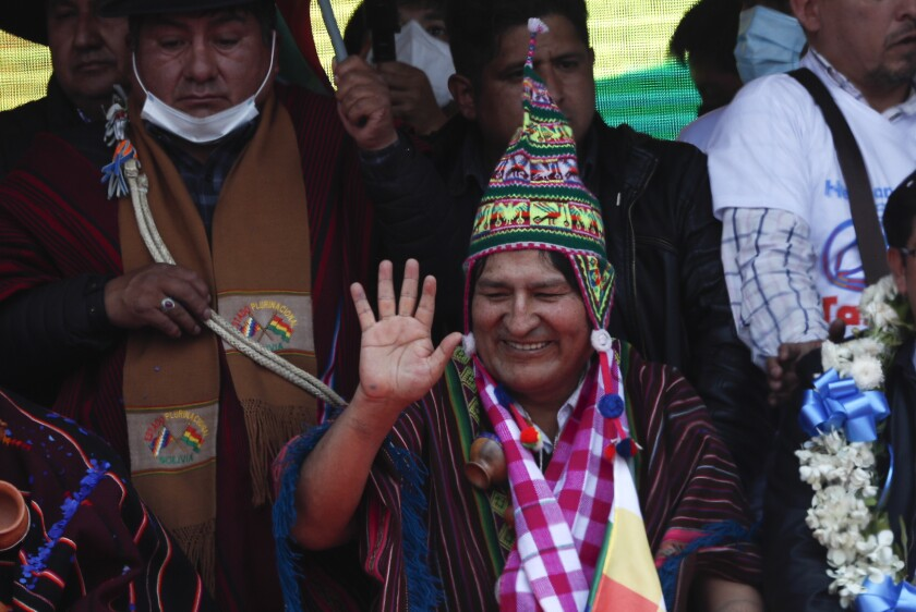 Former president of Bolivia Evo Morales waves to supporters after returning to the country.