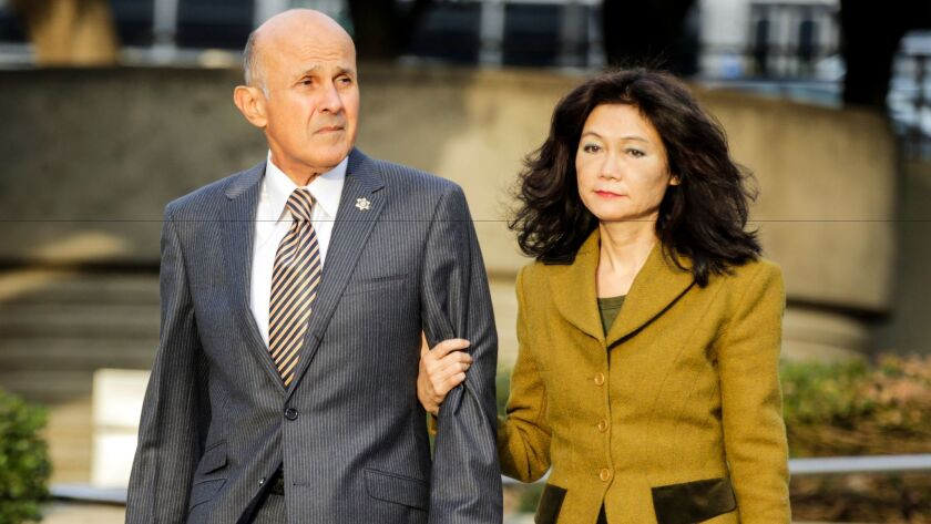 Former Los Angeles County Sheriff Lee Baca and wife, Carol Chiang, arrive at federal court earlier this month for his trial. Baca faces obstruction of justice and conspiracy charges.