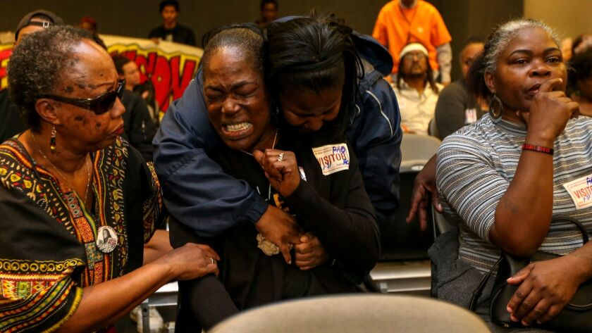 """Lisa Hines, the mother of Wakiesha Wilson, is comforted earlier this year after the Police Commission determined that no LAPD officers were """"substantially involved"""" in her daughter's death."""