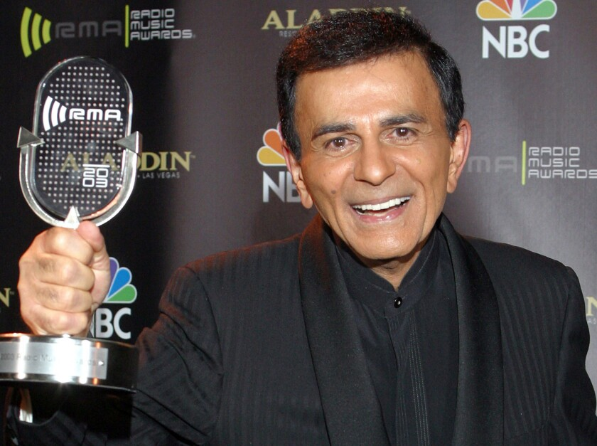 Casey Kasem poses for photographers after receiving the Radio Icon award during the 2003 Radio Music Awards. Kasem died Sunday at age 82.