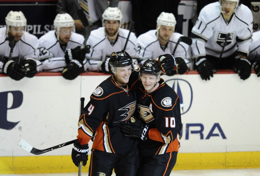 Ducks right wing Corey Perry (10) by defenseman Cam Fowler after scoring the final goal in a 4-2 victory over the Kings on Friday night at Honda Center in Anaheim.