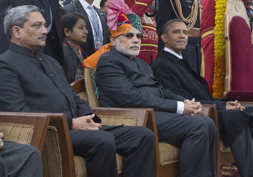 President Obama sits with Indian Prime Minister Narendra Modi, center, during the Republic Day parade in New Delhi on Jan. 26.