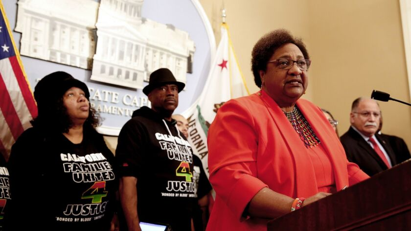 Assemblywoman Shirley Weber (D-San Diego) discusses her bill on police use of force in February in Sacramento. Weber was accompanied by Beatrice Johnson, left, and Cephus Johnson, the aunt and uncle of Oscar Grant, who was killed by BART police in 2009.
