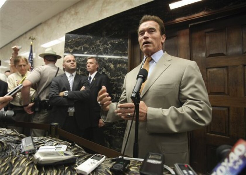 Gov. Arnold Schwarzenegger sounded an optimistic note about ongoing budget negotiations while talking to reporters outside his Capitol office, in Sacramento, Calif., Thursday, July 16, 2009.  Schwarzenegger said that a dispute with Democrats over education funding would not hold up a deal to close
