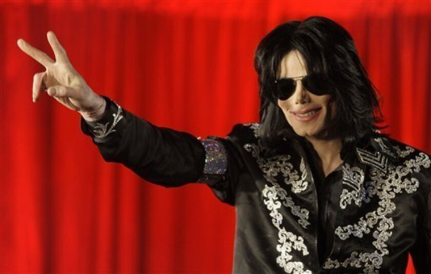 In this March 5, 2009 file photo US singer Michael Jackson announces that he is set to play ten live concerts at the London O2 Arena in July, which he announced at a press conference at the London O2 Arena. A federal judge ruled in favor of Jackson's estate Friday Aug. 10, 2012 that a businessman who operated a website using the likeness and some of the singer's works had infringed copyrights and should be blocked from future usage of the material. (AP Photo/Joel Ryan, File)
