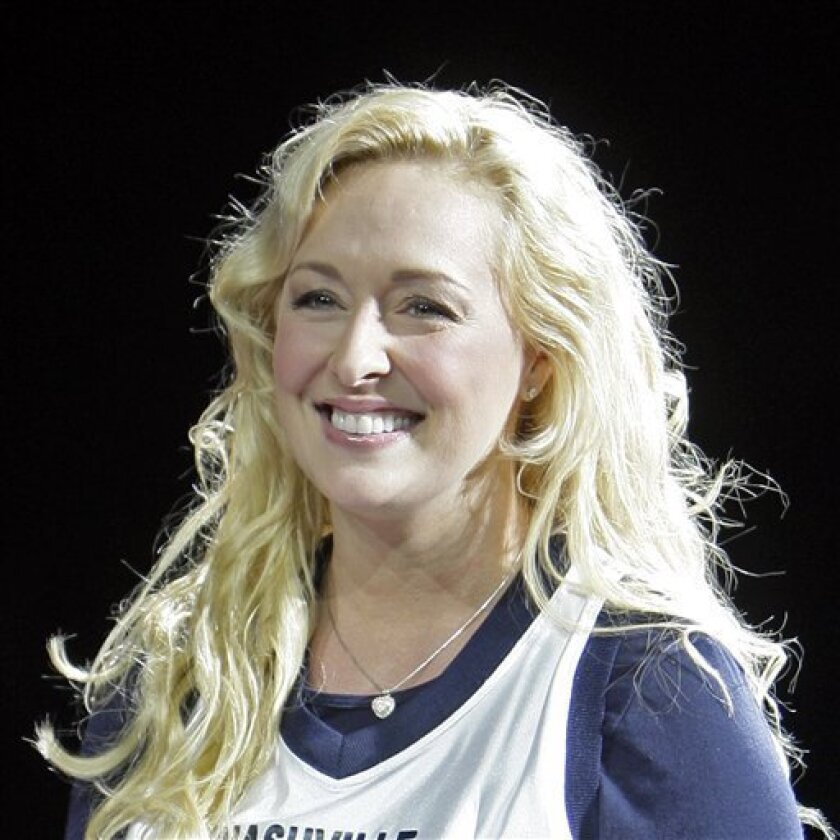 Country singer Mindy McCready performs Nov. 14, 2008, in Nashville, Tenn. Nashville police say McCready has been hospitalized after an apparent suicide attempt Dec. 17. (AP Photo/Mark Humphrey)