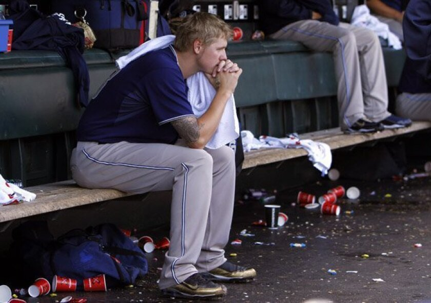 Padres Mat Latos sits on the bench in the 7th inning.