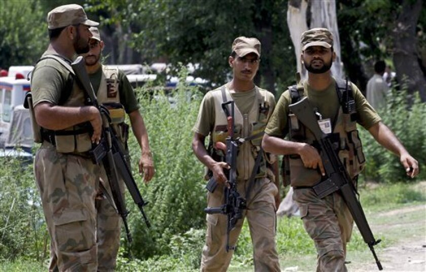 Pakistan army troops arrive to secure an area after an explosion in an Army ammunition depot in Sihala on the outskirts of Islamabad, Pakistan, Monday, July 11, 2011. An explosion at a Pakistani army ammunition depot on the outskirts of Islamabad killed one soldier and injured three others, securit