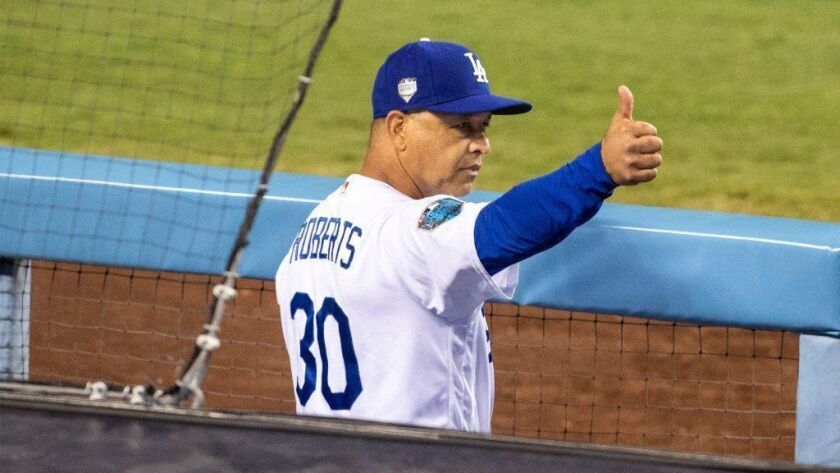 Dodgers manager Dave Roberts gives a thumbs up during Game 5 of the World Series against the Red Sox on Oct. 28.