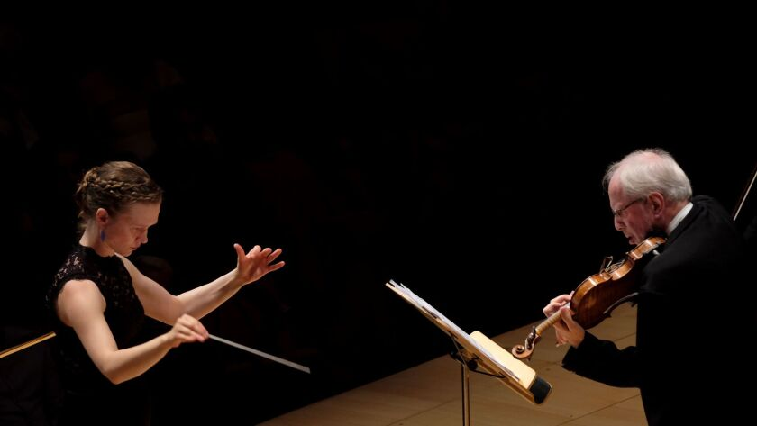 LOS ANGELES, CA October 19, 2017: Mirga Grazinyte-Tyla, left, conducts the LA Phil and Gidon Kre