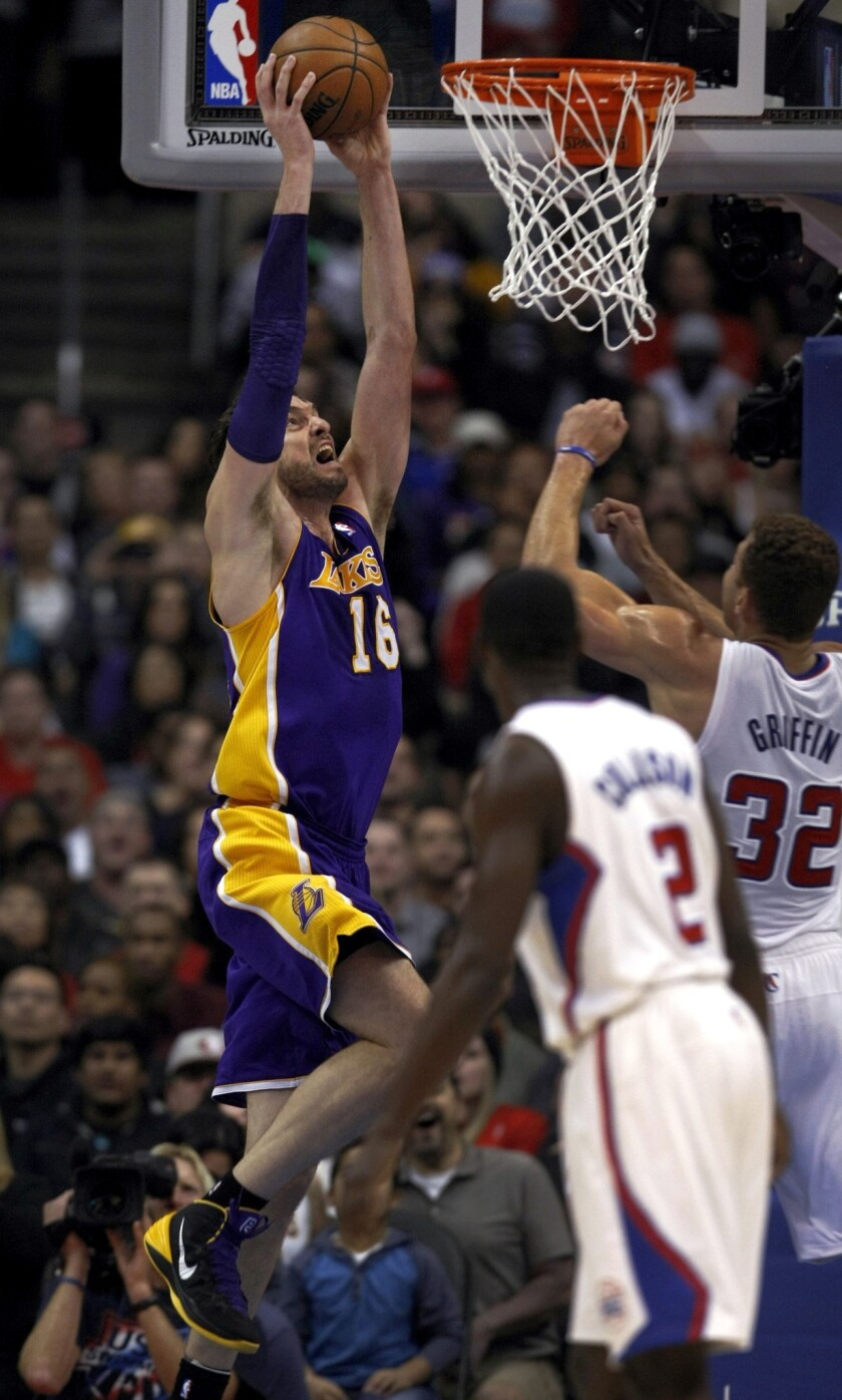 The Lakers' Pau Gasol goes up for a dunk against the Clippers.