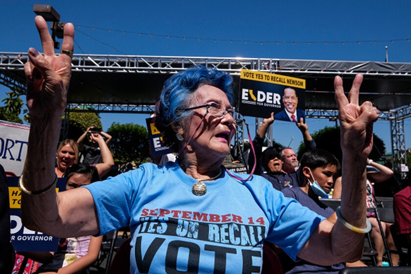 A supporter gestures the victory sign as Republican gubernatorial candidate Larry Elder speaks