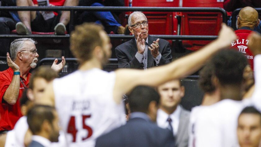 Steve Fisher cheers the Aztecs during a timeout at a game last season after retiring as head coach in 2017.