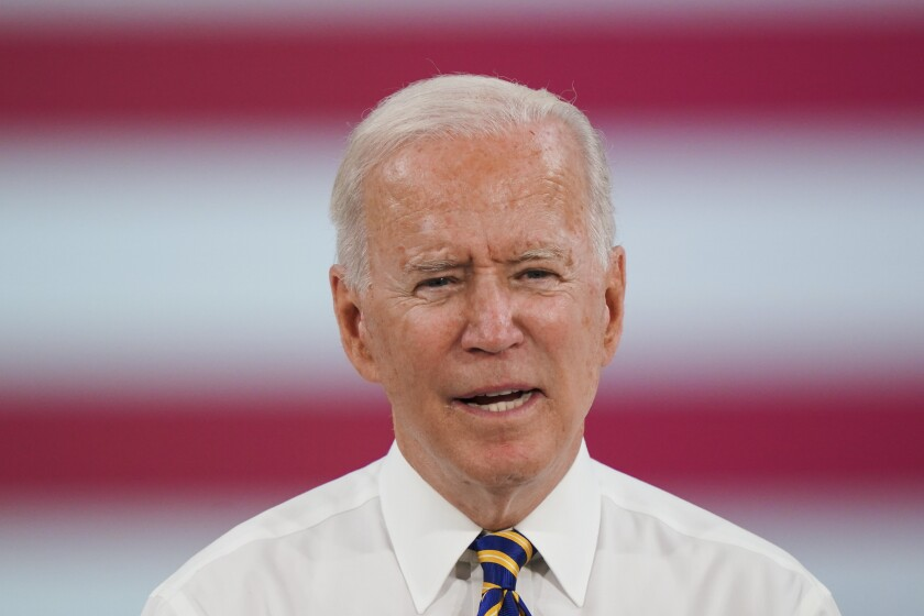 A closeup of President Biden in shirt and tie.