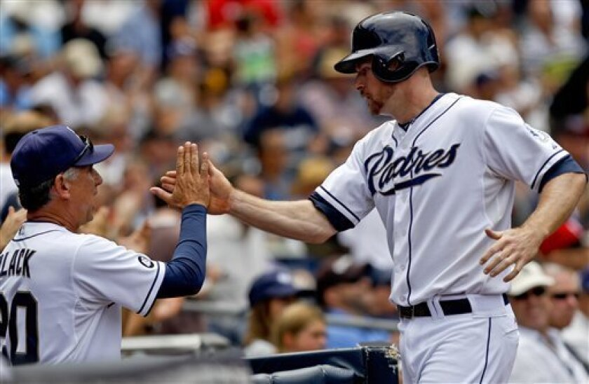 San Diego Padres' Chase Headley is congratulated by manager Bud Black, left, after scoring during the Padres' five run fourth inning rally against the Houston Astros during a baseball game, Wednesday, July 18, 2012, in San Diego. (AP Photo/Lenny Ignelzi)