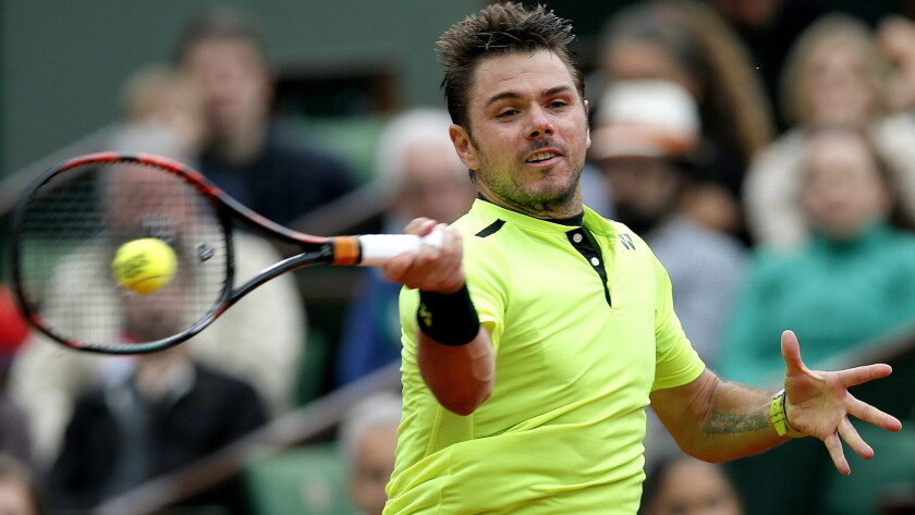 Stan Wawrinka returns a shot against Viktor Troicki during their fourth-round match at the French Open on Sunday.