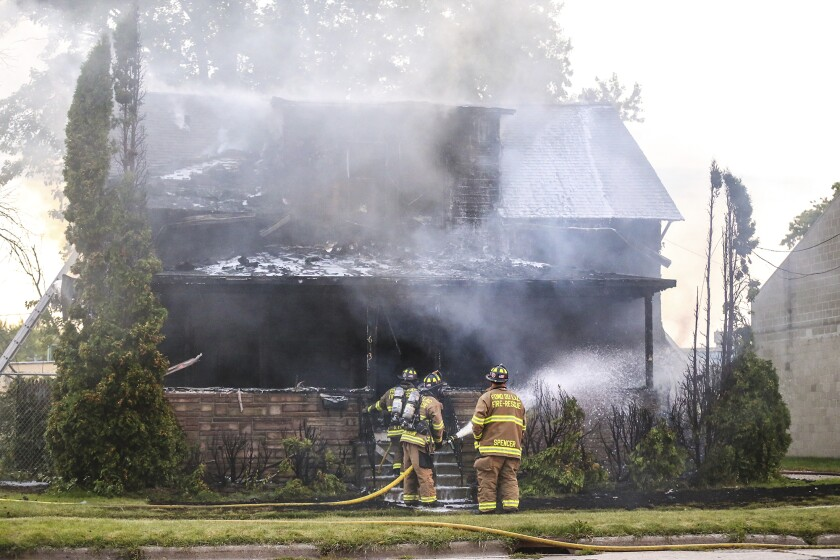 City of Fond du Lac Fire Rescue crews work a house fire Thursday, Sept. 19, 2019 in Fond du Lac, Wis. Officials say three people have died in the fire at the group home for people with disabilities. (Doug Raflik/The Reporter via AP)