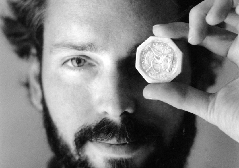 FILE -In this November 1989 file photo, Tommy Thompson holds a $50 pioneer gold piece retrieved earlier in 1989 from the wreck of the gold ship Central America. According to the US Marshals Service,  Thompson, a fugitive treasure hunter wanted for more than 2 years was arrested in Florida. (AP Phot